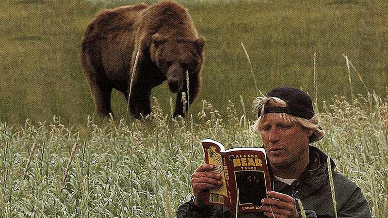 Grizzly man reading a book